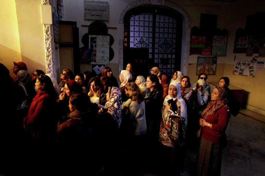 MANU BRABO : ASSOCIATED PRESS WAITING THEIR TURN: Women line up at a polling center in Cairo for a chance to vote in the country's parliamentary election. Egyptians on Monday began voting in their nation's first parliamentary elections since Hosni Mubarak's ouster. Photo: Manu Brabo / AP