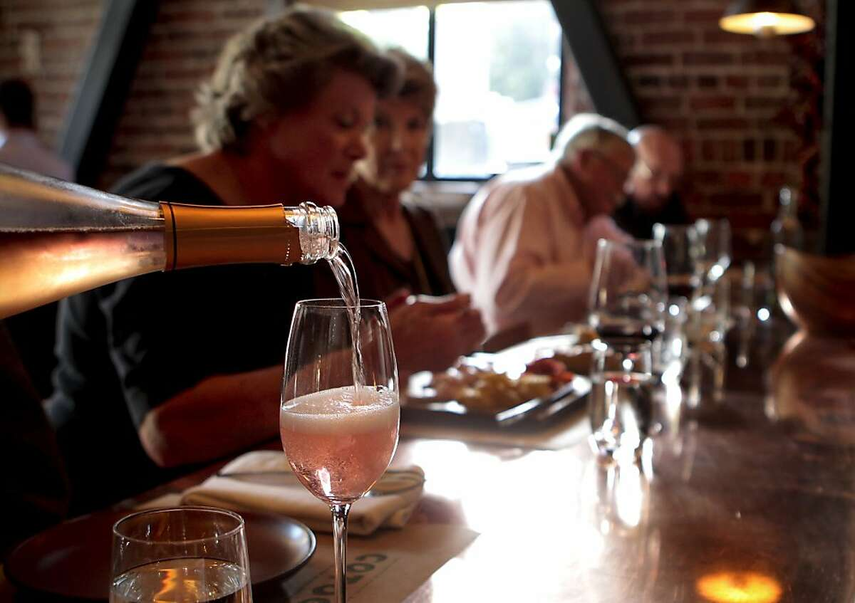 Sparkling wine is poured for customers at Cotogna Restaurant in San Francisco, Calif., on June 9th, 2011.