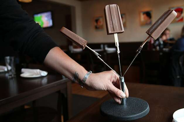 The Fudgsicle dessert is served from a modified microphone stand at Bar Bocce. When customers only order dessert for two the bill is placed in the middle clip. Photo: Alex Washburn, Special To The Chronicle