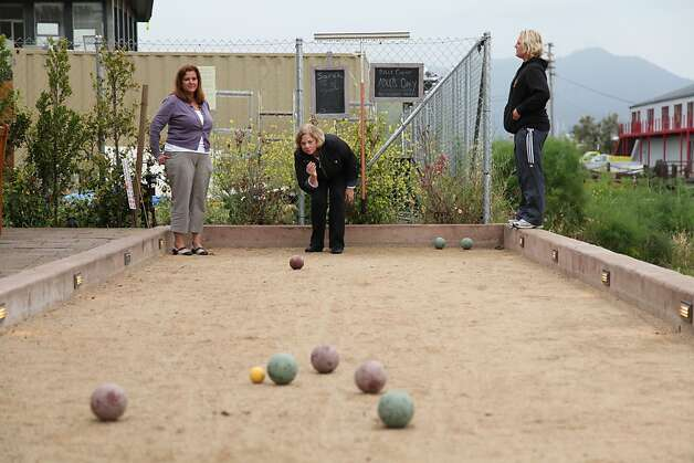 From left, Anna Lazzarini, Suzanne Chase and Sarah Petrini play bocce ball next to the patio at Bar Bocce in Sausalito. Photo: Alex Washburn, Special To The Chronicle