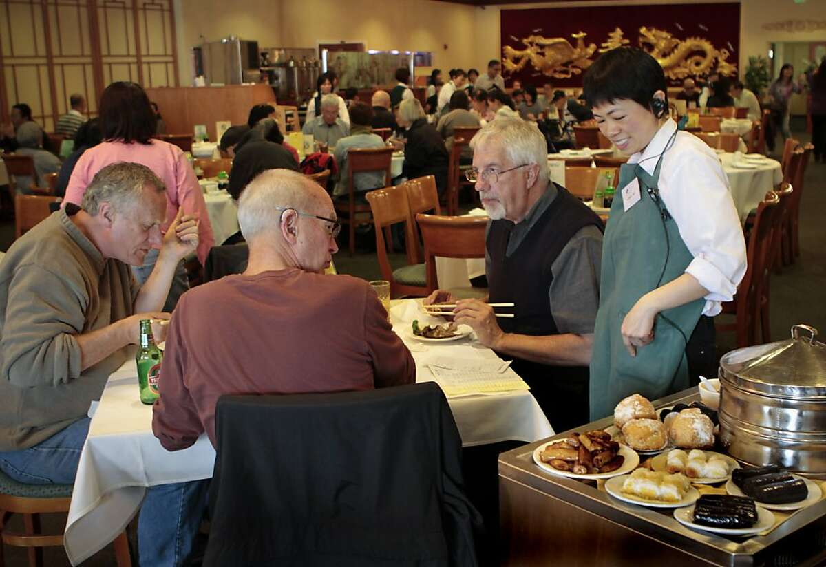 A server shows diners choices from the Dim Sum cart at the East Ocean Seafood Restaurant in Alameda, Calif. on June 3rd, 2011.