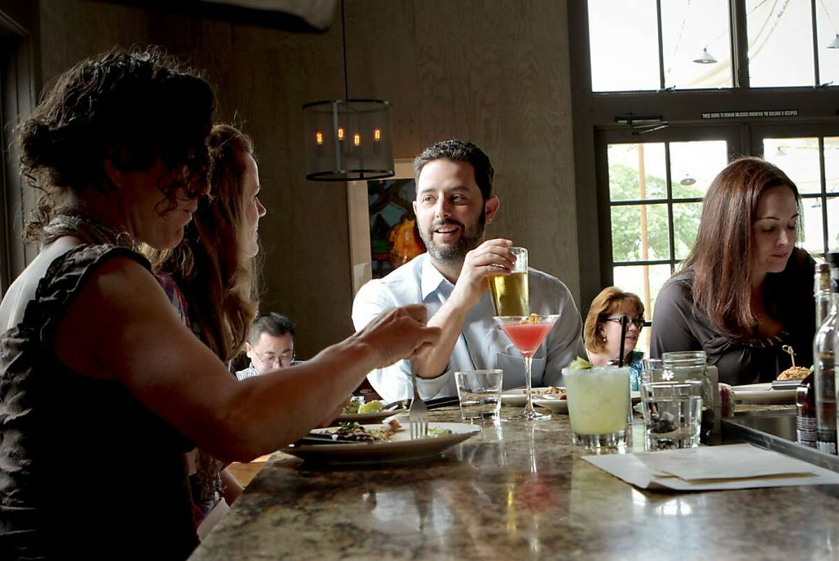 Diners enjoy appetizers at the Farmstead restaurant in St. Helena, Calif., on Saturday, May 28th, 2011.