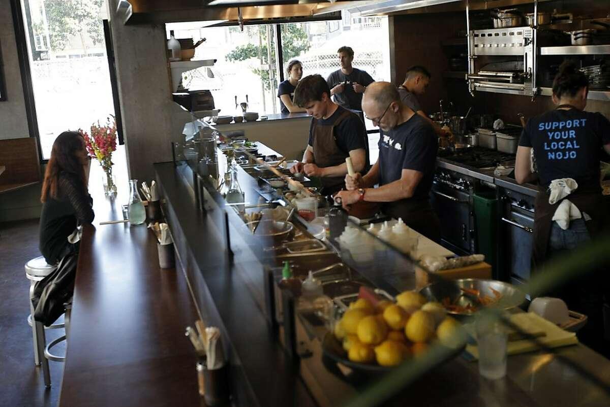 Food being prepared behind the bar at Nojo.