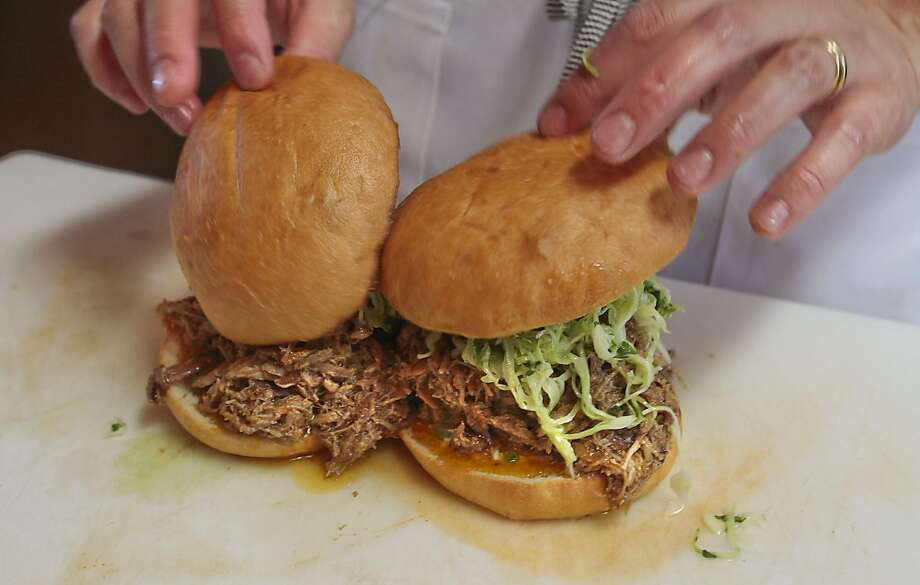 "The ""Spicy Hog"" sandwich being assembled at Restaurant Southie in Oakland, Calif. is seen on Thursday, May 5th,  2011. Photo: John Storey, Special To The Chronicle"