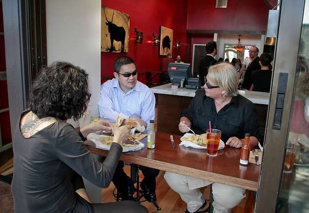 Diners enjoy lunch at Restaurant Southie in Oakland, Calif. on Thursday, May 5th,  2011. Photo: John Storey, Special To The Chronicle