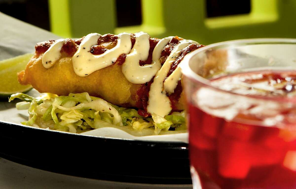 The Baja Pescado taco with a glass of Sangria at Tacobar.