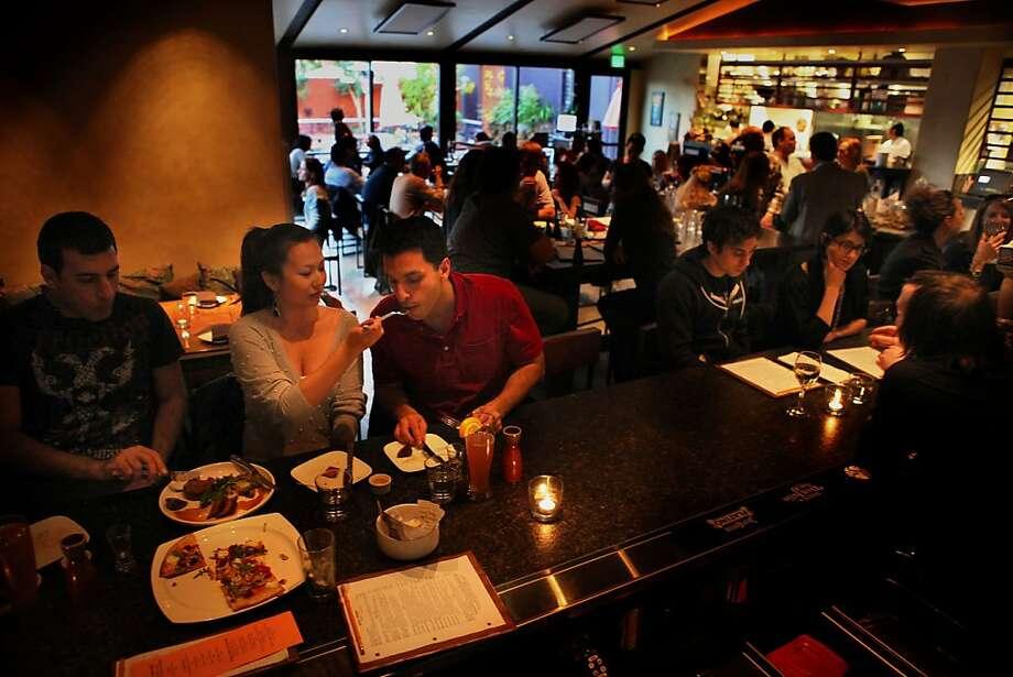 The bar area at Skool during the dinner hour in San Francisco, Calif., on Thursday,  April 28, 2011. Photo: Liz Hafalia, The Chronicle