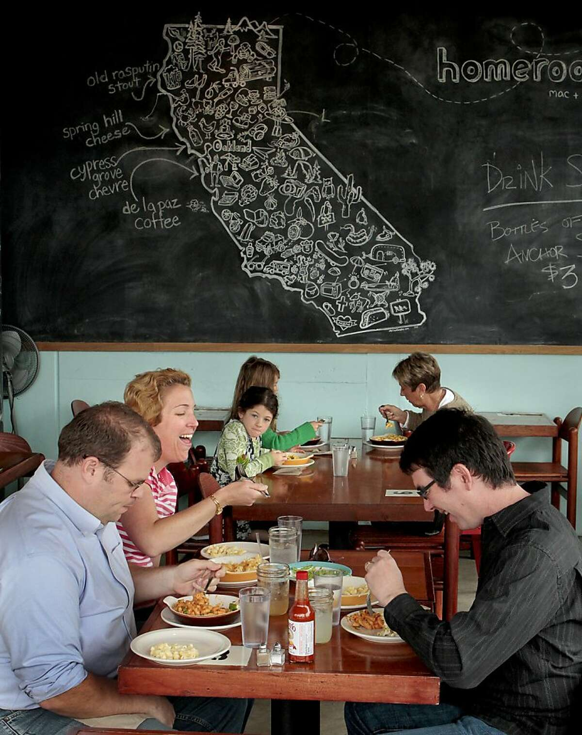 Diners enjoy lunch at Homeroom Mac + Cheese Restaurant in Oakland, Calif. on Wednesday, April 20th, 2011. Ran on: 04-28-2011 Diners at Homeroom get some form or another of macaroni and cheese, served in a casual place with blackboard walls.