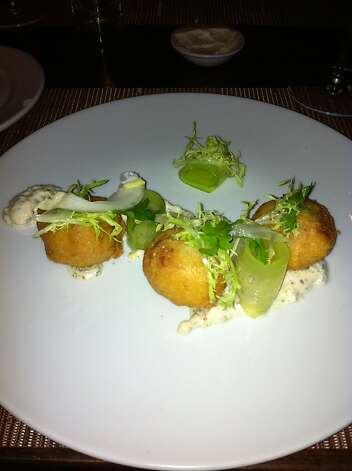 Baltimore crab fluffs with English cucumber, winter chicories and remoulade sauce, at Maverick restaurant in San Francisco; photographed in April 2011. Photo: Michael Bauer, The Chronicle