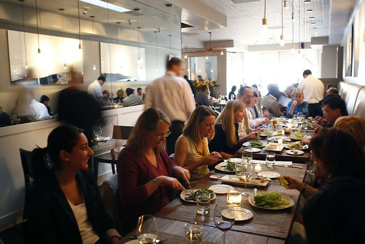 A large group of diners mingles over a meal at Hudson in Oakland Calif, on Tuesday, April 12, 2011.
