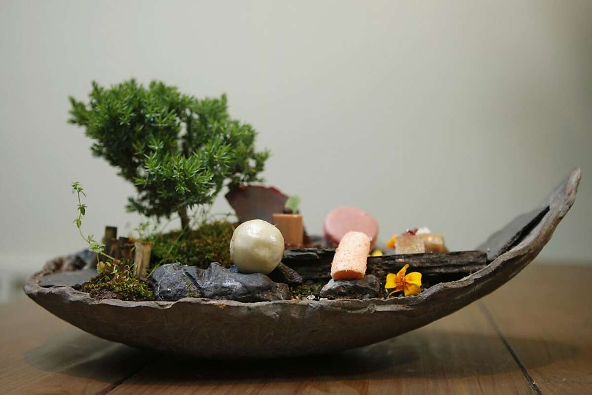 A chocolate pearl, guava macaron, lychee rose patŽ de' fruit among other delicacies are served on a bonsai forest at Atelier Crenn on Wednesday, March 30, 2011.