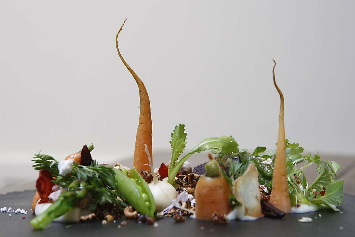 Le Jardin du Printemps is presented at Atelier Crenn with spring vegetables such as carrots, turnips, peas and asparagus as well as salted walnuts and wild rice on Wednesday, March 30, 2011.