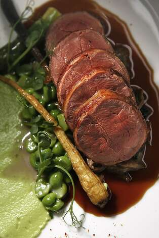 Slow cooked squab--english peas, black trumpets, bacon, foie gras-squab jus, piment d'espelette--prepared at Fifth Floor restaurant in San Francisco, Calif., in his kitchen on Monday, March 22, 2011. Photo: Liz Hafalia, The Chronicle