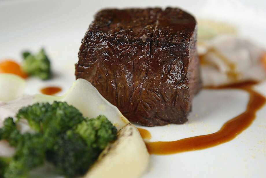 The butcher's steak comes with taro root, sour orange and broccoli at eVe in Berkeley Calif, on Saturday, March 19, 2011. Photo: Alex Washburn, The Chronicle