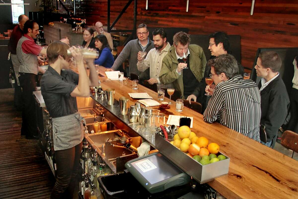 A bartender shakes a cocktail at Bar Agricole in San Francisco, Calif. on Saturday, March 12th 2011.
