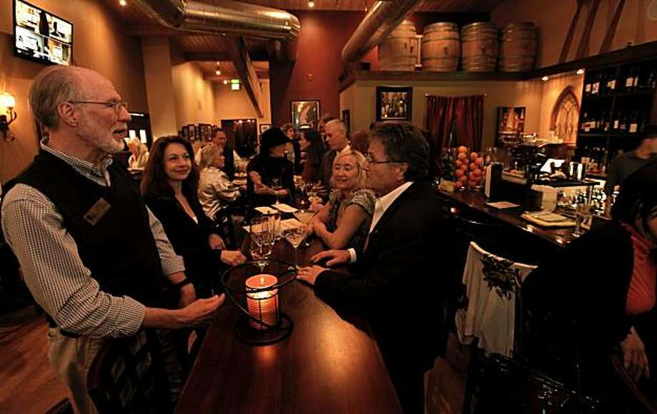 (left to right) Jerry Peters, Lorna Johnson, Shelley Shepherd Klaner and Jay Strauss enjoy the communal table over drinks at Ghiringhelli Pizzeria Grill and Bar in Novato, Ca., on Tuesday March, 8, 2011. Photo: Michael Macor, The Chronicle