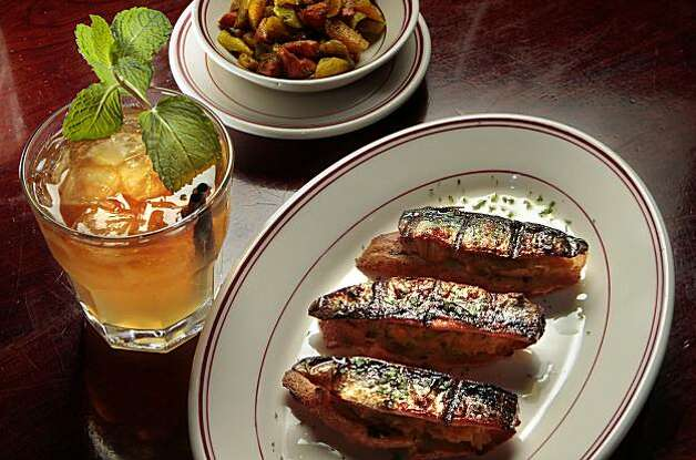 The grilled Sardine Crostini with a Mai Tai at the Presidio Social Club in San Francisco, Calif.,  is seen on Thursday,  February 17th,  2011. Photo: John Storey, Special To The Chronicle