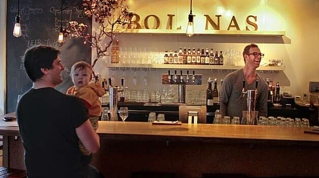 A father and son enjoy a glass of wine at 123 Bolinas restaurant in Fairfax, Calif., is seen on Thursday, March 3rd,  2011. Photo: John Storey, Special To The Chronicle