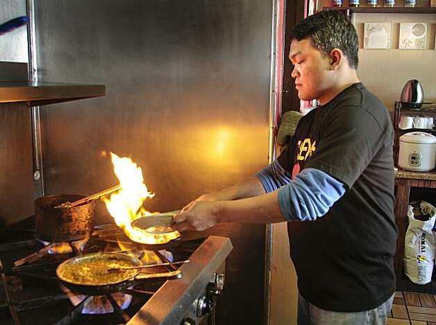 Oliver Santos cooks at Tselogs restaurant in Daly City,  Calif., on Friday,  February 25th,  2011. Photo: John Storey, Special To The Chronicle