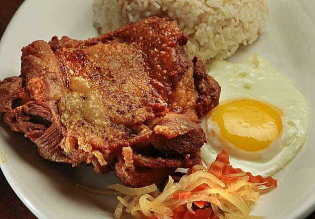 Noksilog at the Tselogs restaurant in Daly City,  Calif.,  is seen on Friday,  February 25th,  2011. Photo: John Storey, Special To The Chronicle