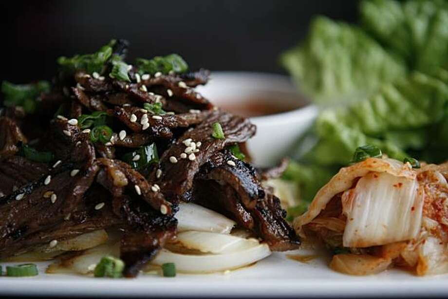 The Korean lettuce wraps come with grilled beef short ribs, kimchee, mizuna and bean sprouts at The Attic in San Mateo Calif, on Saturday, Feb. 19, 2011. Photo: Alex Washburn, The Chronicle