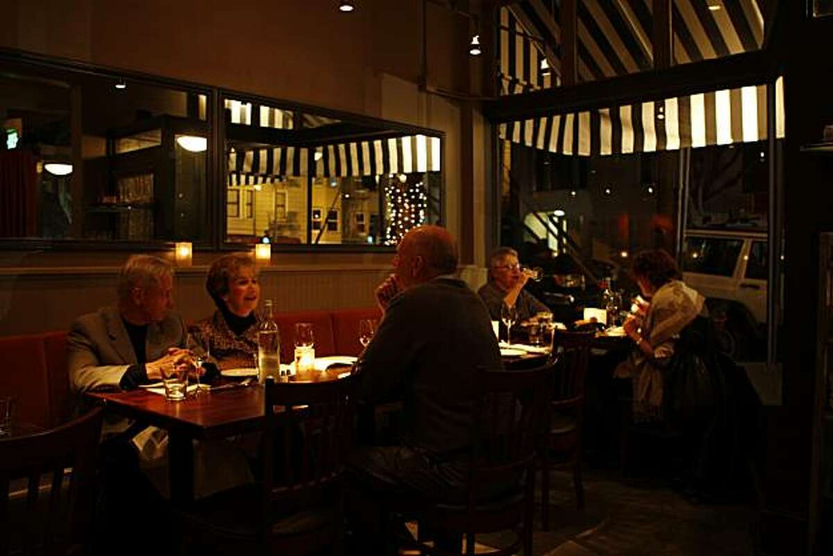 Patrons make quiet conversation at Seven Hills Restaurant in San Francisco Calif, on Tuesday, Feb. 22, 2011.
