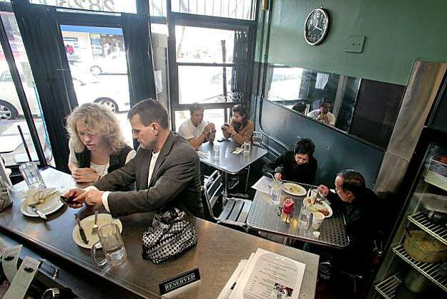 Diners enoy lunch at Mr. Pollo restaurant in San Francisco, Calif., on Saturday, January 15th,  2011. Photo: John Storey, Special To The Chronicle