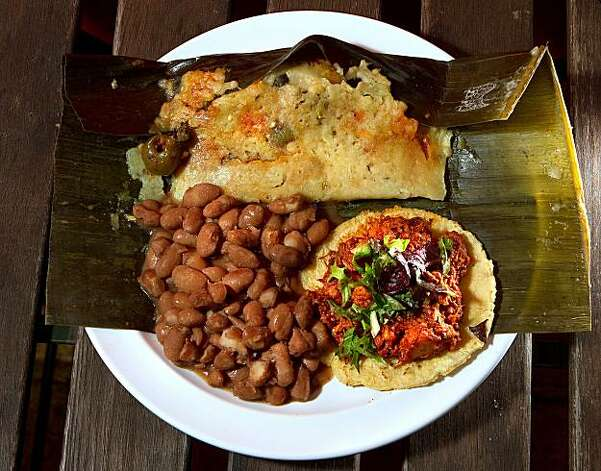 The soft Tacos at Flacos restaurant in Berkeley Calif., is seen on Saturday, January 8, 2011.  Ran on: 01-13-2011 Clockwise from below: Flacos is a restaurant in Berkeley that also maintains its presence at the farmers' markets where it got started. The menu includes vegan renditions of traditional Mexican food like soft tacos, and drinks like Mexican hot chocolate. Photo: John Storey, Special To The Chronicle