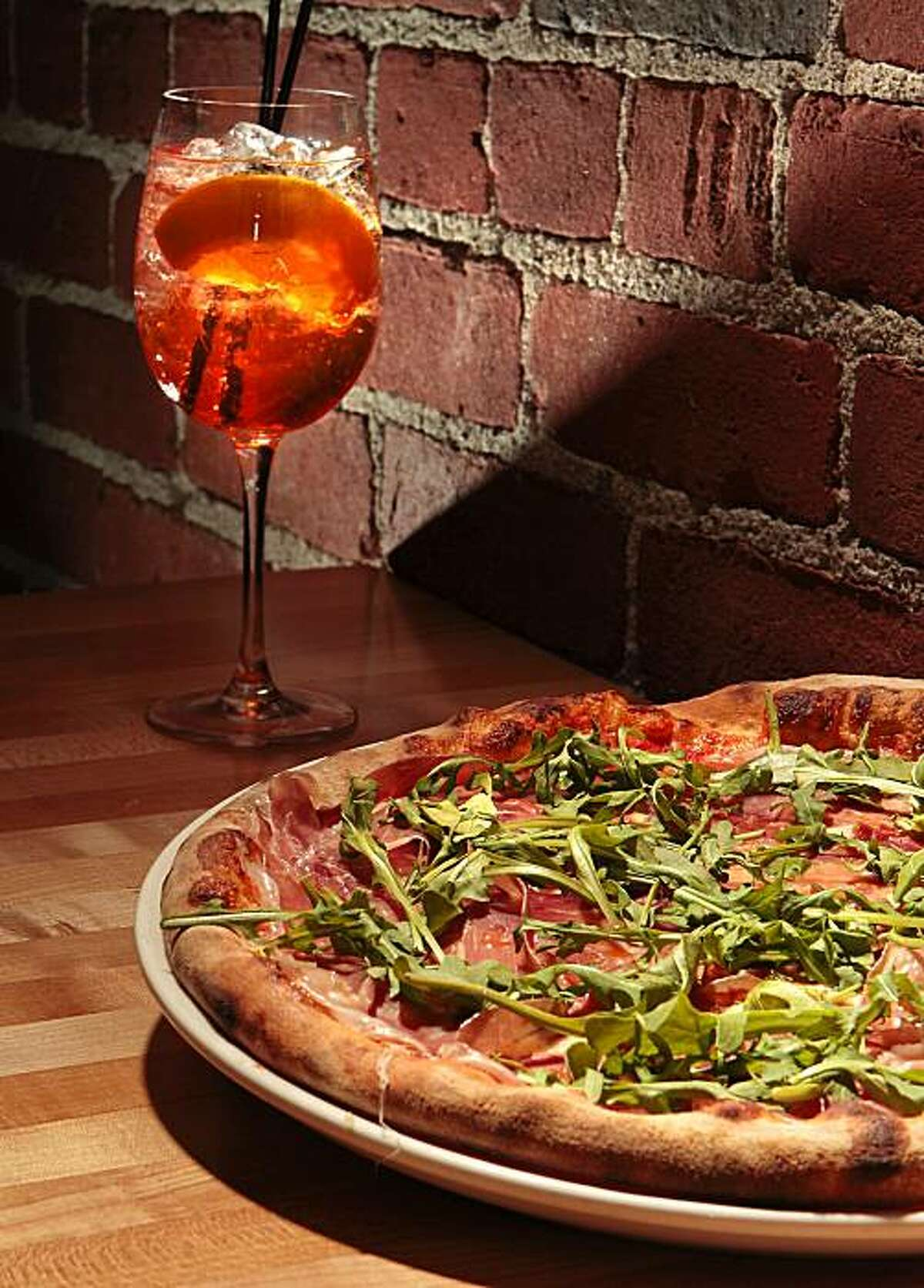 """The """"Sonja"""" pizza with """"Spritz"""", an Italian aperitif, at Diavola Pizzeria in Geyserville, Calif., is seen on Sunday, January 2, 2011."""