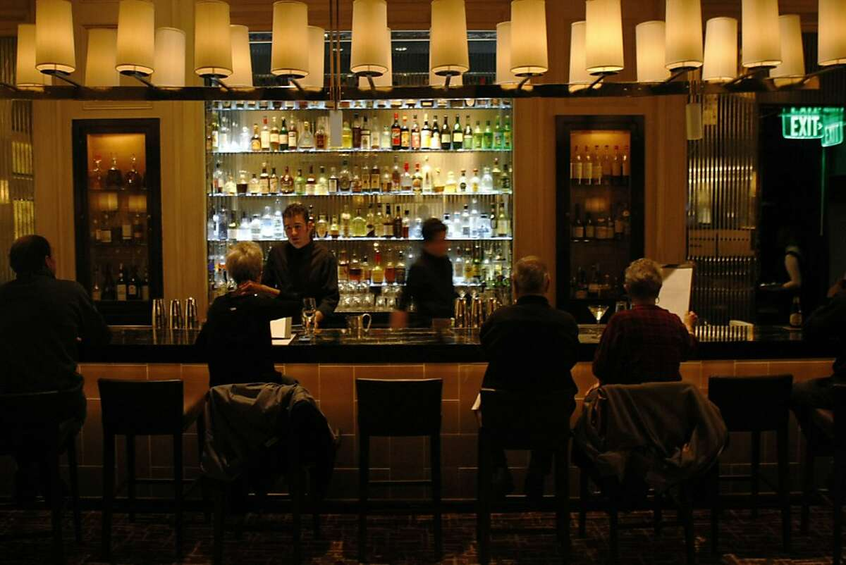 Customers drink at the bar in Bourbon Steak on Tuesday, December 7, 2010, San Francisco, Calif. Bourbon Steak is the new restaurant that took over Michael Mina.