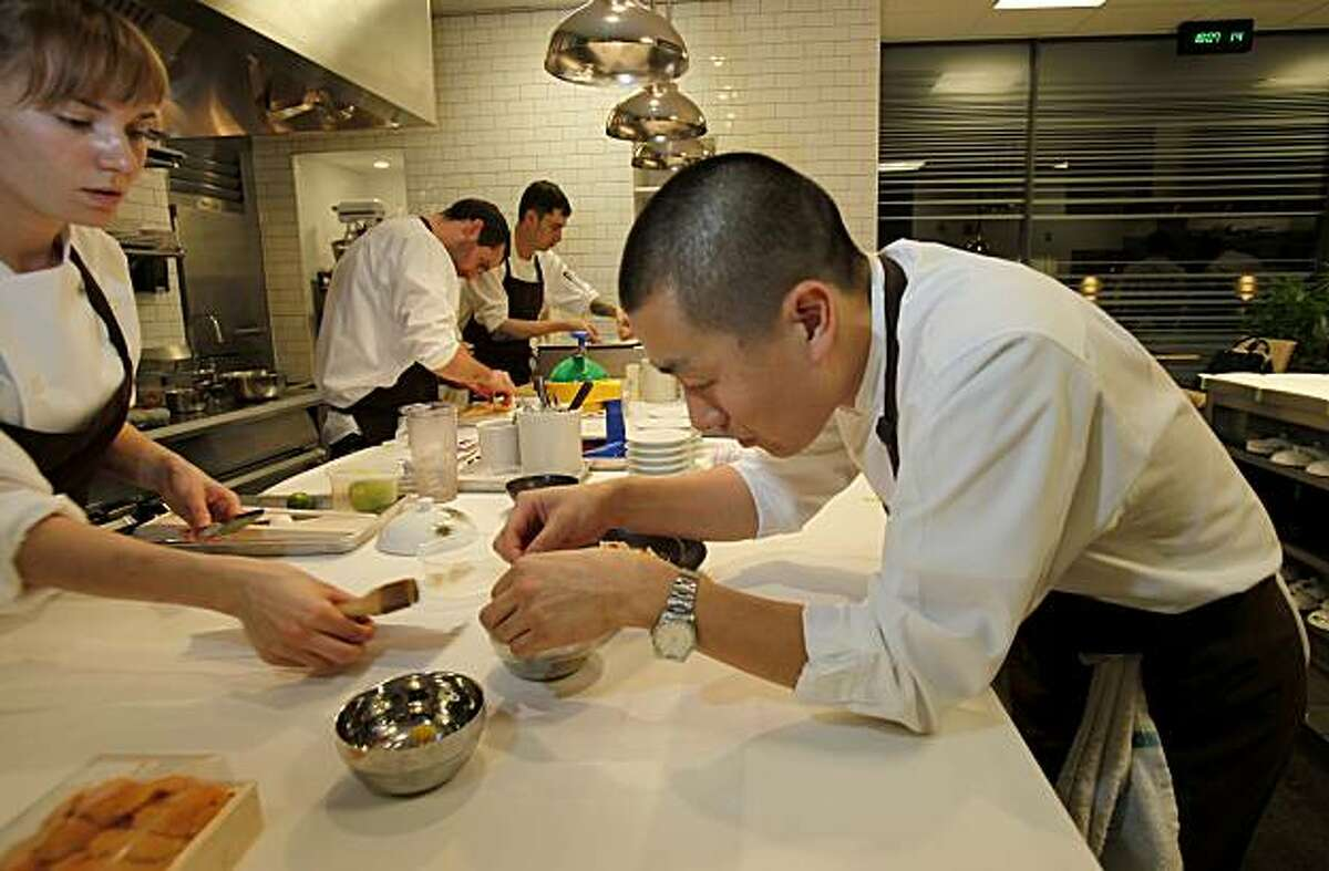 Chef Lee works on a presentation in the elaborate kitchen at Benu. Benu is a new restaurant by former French Laundry Chef du Cuisine Corey Lee in San Francisco, Calif.