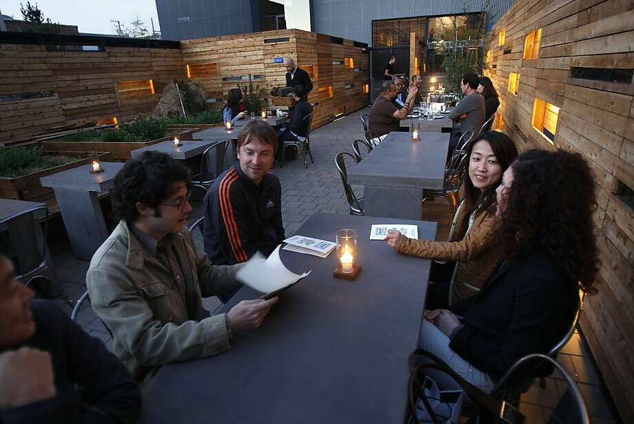 The patio area at Bar Agricole during the dinner hour in San Francisco, Calif., on Friday, October 15, 2010.  Ran on: 10-31-2010 Bar Agricole's courtyard includes planters with herbs and outdoor seating for 36. Photo: Liz Hafalia, The Chronicle