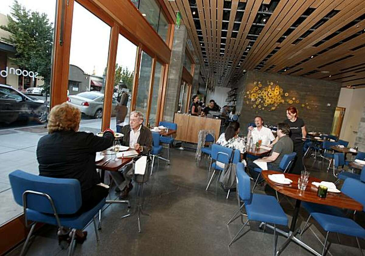 The dining area at Spoonbar features large windows looking out on the sidewalk. Spoonbar is a new bar/restaurant near the plaza in downtown Healdsburg, Calif., located below a new green hotel.