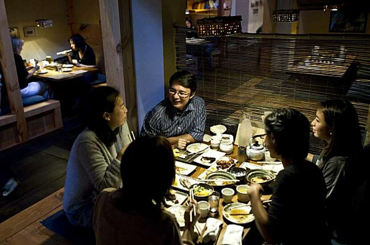 Duncan Williams talks with his friends while eating dinner at Ippuku in Berkeley, Calif., on Wednesday, September 22, 2010.