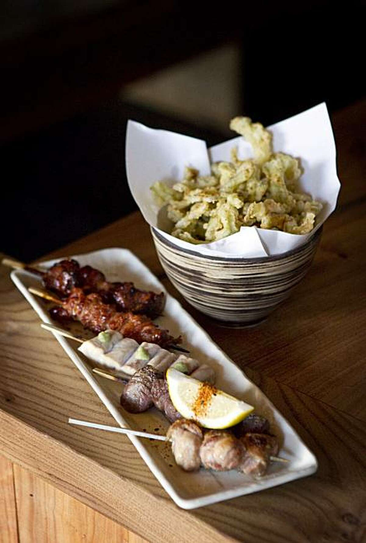 A plate of five chicken skewers and a bitter melon tempura are seen at Ippuku in Berkeley, Calif., on Wednesday, September 22, 2010.