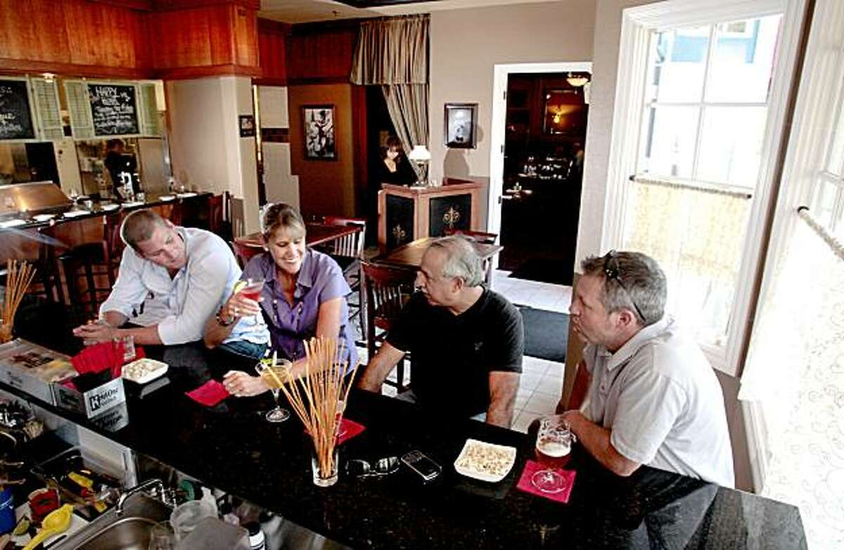 Jared Goble, Robin Goble, Mark Millan and Tom Gorman, (left to right), have a drink at Bistro M restaurant in Windsor on Friday, August 20, 2010.