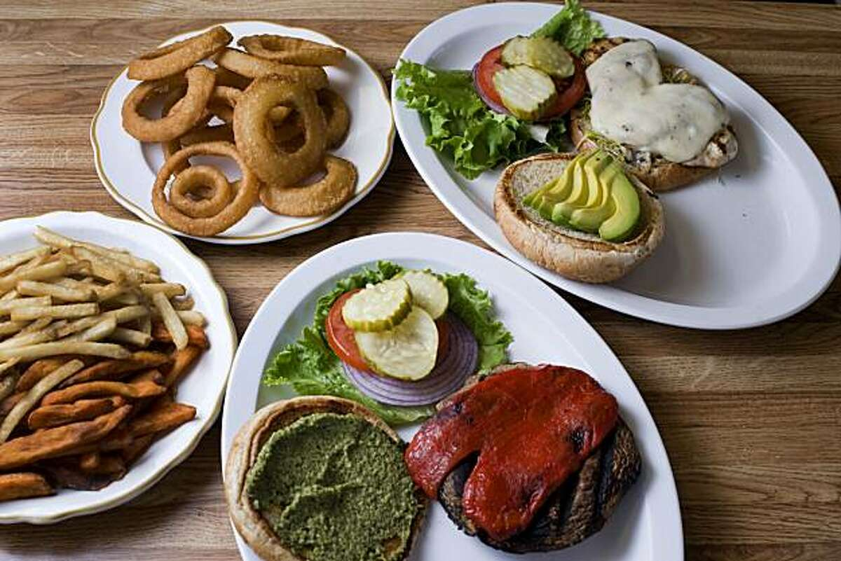 Clockwise from left, the French Fry/Sweet Potato Fry combo, onion rings, California Chicken Sandwich with sprouts and avocado and the