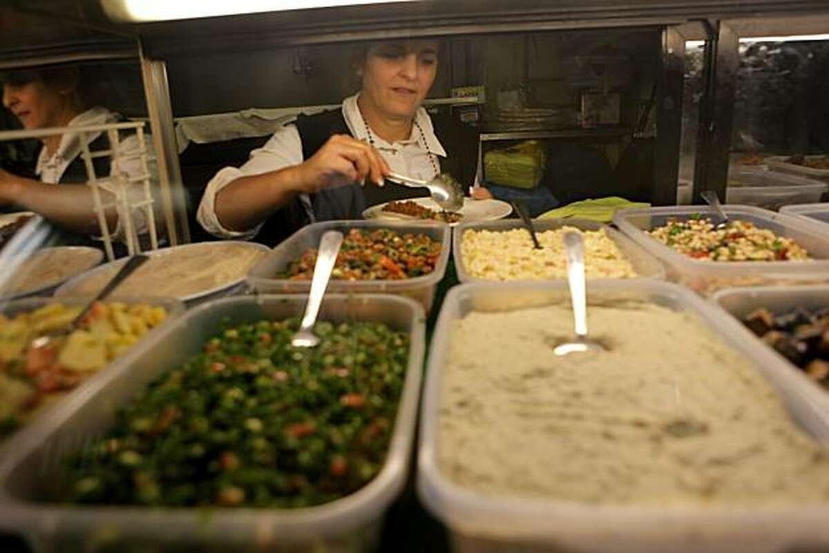 Hulya Besif prepares a appetizer platter at Eden's Mediterranean Turkish and Greek Restaurant, Monday August 23, 2010, in San Francisco, Calif.