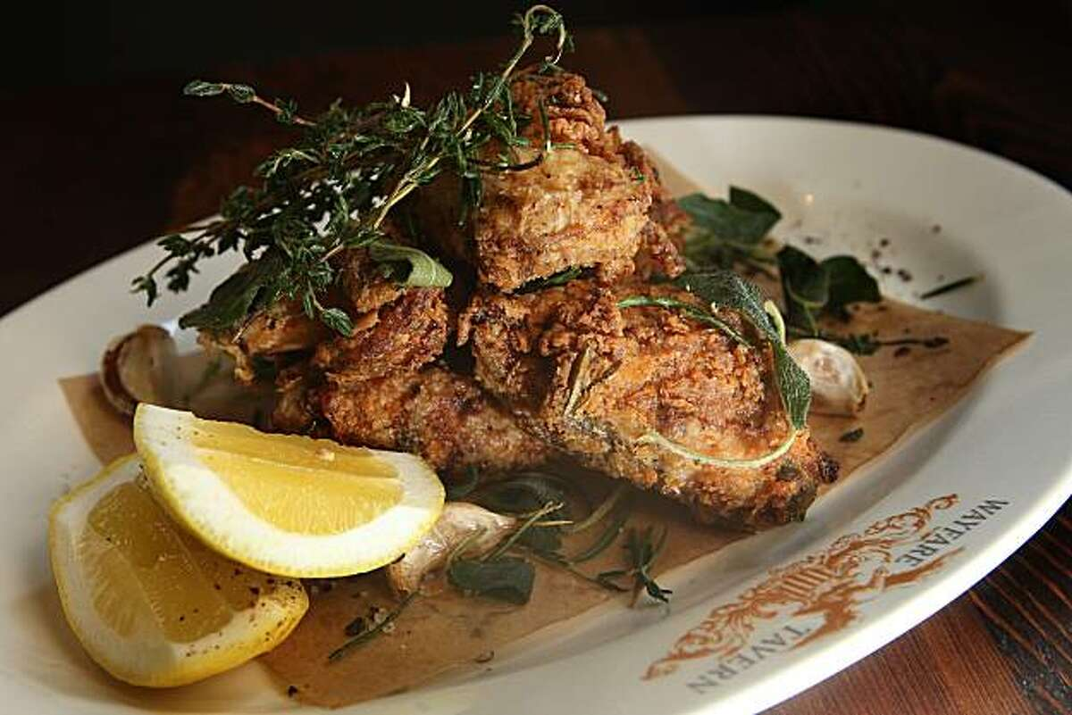 Organic fried chicken with buttermilk brine, roasted garlic, crisp woody herbs, and lemon at the Wayfare Tavern in San Francisco, Calif., on Wednesday, August 25, 2010.