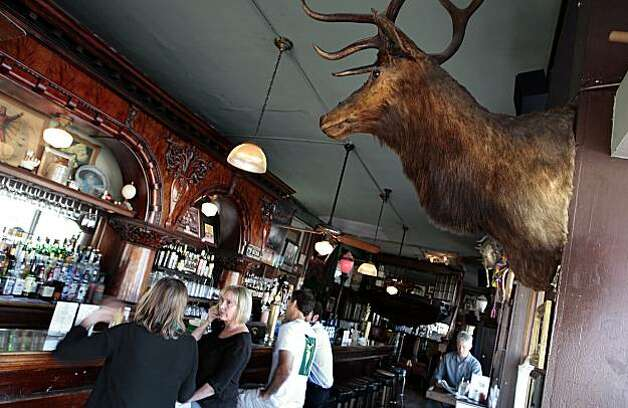 Kimberly Giddings (left) and Deborah Johnson have lunch at the Hotel Utah Saloon in San Francisco on Wednesday,  August 18th, 2010.  Ran on: 08-26-2010 Kimberly Giddings (left) and Deborah Johnson have lunch at the Hotel Utah Saloon in San Francisco, above. The saloon, far right, which has been around since 1908, includes a variety of menu staples, including a cheeseburger, right. There is a steady stream of music, whether onstage or from the jukebox. Photo: John Storey, SPECIAL TO THE CHRONICLE