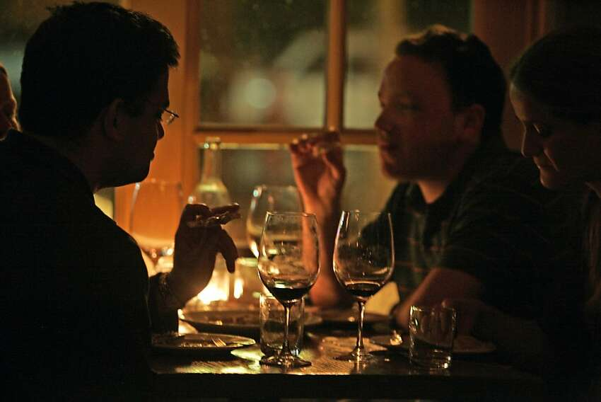 Customers enjoy a College Avenue hotspot in Oakland called A Cote. An intimate restaurant that offers specialty cocktails and French/Mediterranean small plates like Italian Sausage Flatbread, Mussels with Pernod from a wood oven and Pear Gorgonzola Flatbread. Drinks include El Pepino a gin-lime cucumber, cranberry Martini type drink and The Guyana Star made with Plantation Barbados Rum, ginger and limejuice. DECEMBER 09, 2006OAKLAND.By Lance Iversen/San Francisco Chronicle