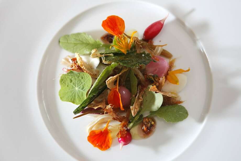 Garden radishes, pigs ear and nasturtium honey, is one of the dishes prepared at the newly remodeled Saison restaurant, Tuesday August 10, 2010, in San Francisco, Calif. Photo: Lacy Atkins, THE CHRONICLE