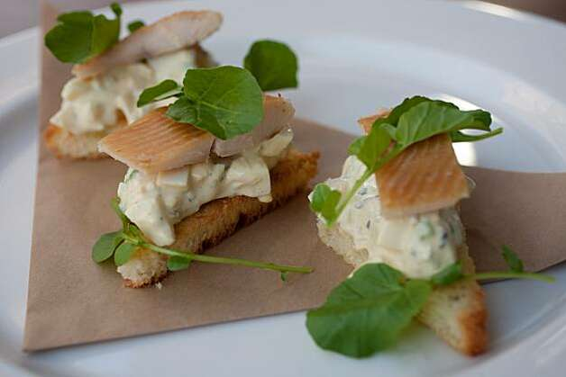 A plate of smoked trout with truffled egg salad on toast and finished with watercress as served at Brick and Bottle on July 31, 2010 in Corte Madera, Calif. Photo: John Sebastian Russo, The Chronicle