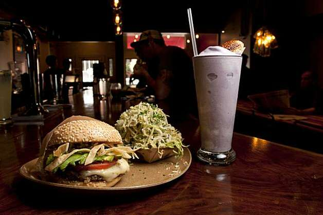 The Tejano beef burger is pictured with a Zucchini-Onion Haystack and a Pomegranete Blueberry Shake at Roam in Cow Hollow.  Roam features artisan burgers, is photographed in San Francisco, Calif., on Thursday, July 29, 2010. Photo: Chad Ziemendorf, The Chronicle