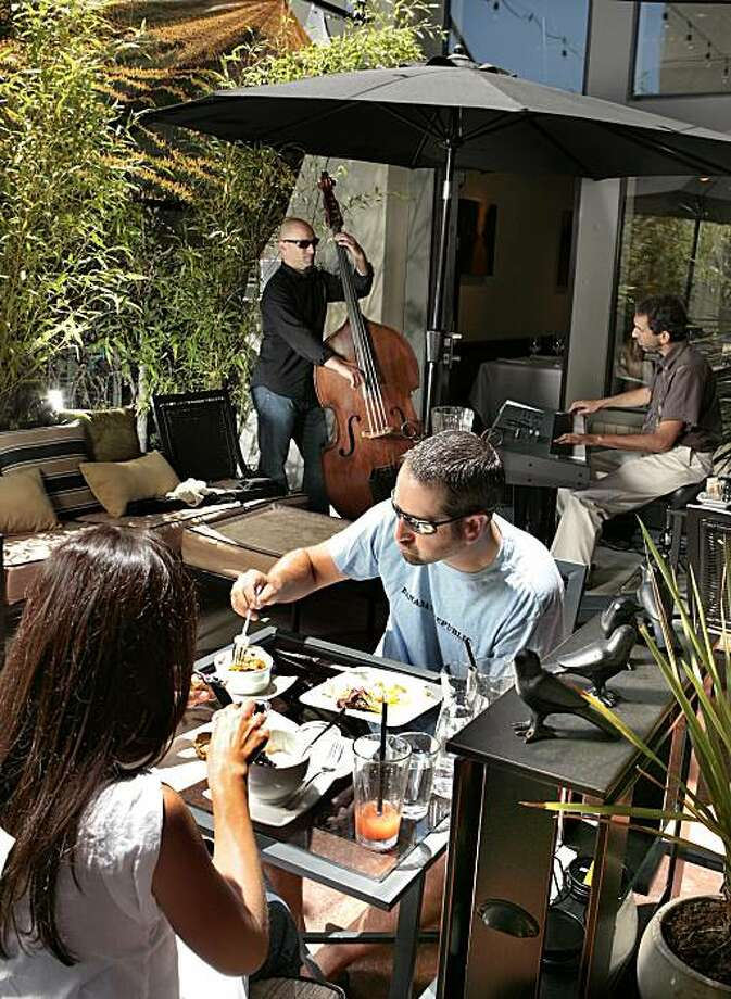 Bill Smart and his wife Danielle Smart of Healdsburg enjoy brunch at Affronti  restaurant in Healdsburg on Sunday, July  25, 2010. Andrew Emer plays bass with Dan Zemelman on the piano in the background. Photo: John Storey, Special To The Chronicle