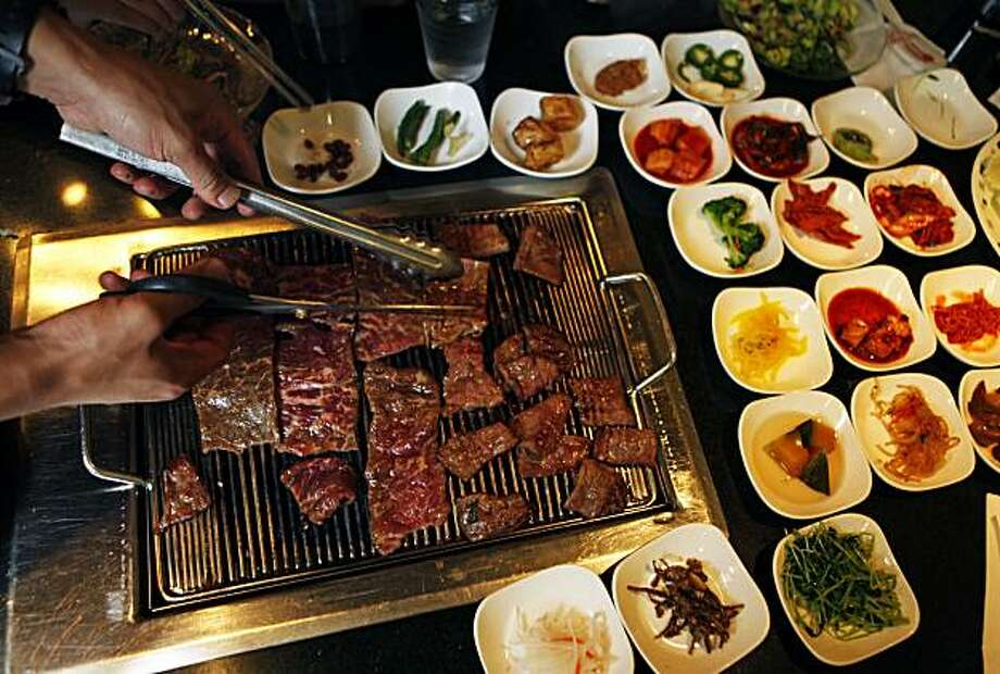 Ohgane korean bbq oakland grill meat yourself sfgate - How to build a korean bbq table ...