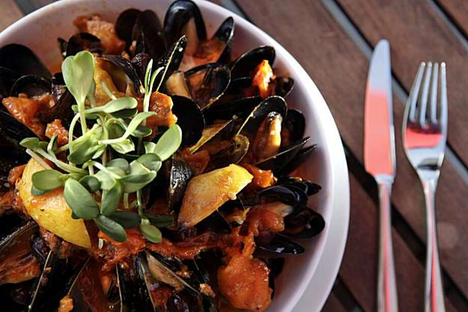 The P.E.I. MUSSELS with white wine, Noilly Prat, roasted orange cluster tomatoes, Nicoise olives and preserved lemon, served L'Appart is a new french restaurant in San Anselmo, Calif., seen here on Tuesday, July 20, 2010. Photo: Carlos Avila Gonzalez, The Chronicle