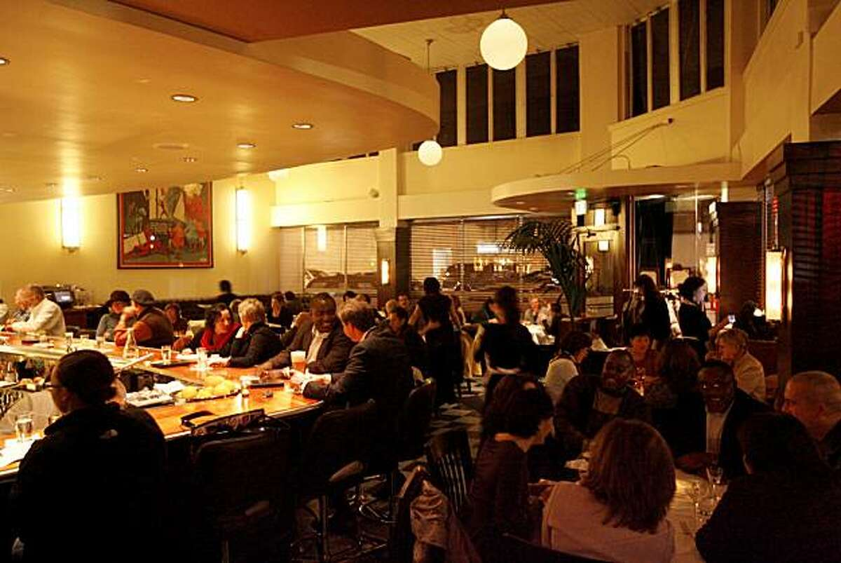 FLORA: The dining room and bar at Flora, a restaurant in downtown Oakland.