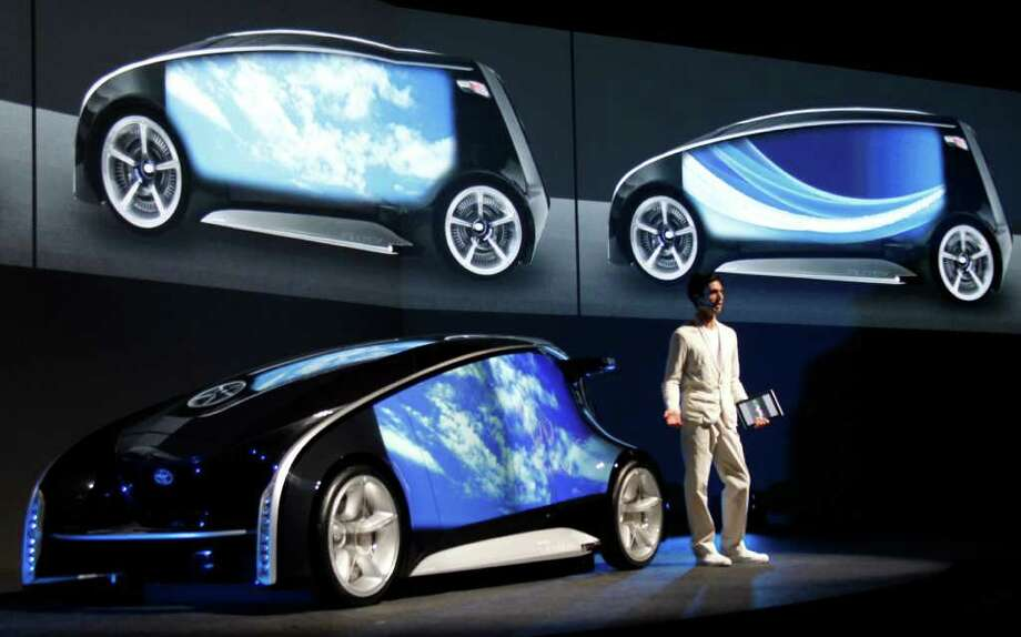 KOJI SASAHARA : ASSOCIATED PRESS 'SMARTPHONE ON FOUR WHEELS': Toyota's experimental Fun-Vii is previewed before the opening of the Tokyo Motor Show. Toyota gave no date for when it might be produced. Photo: Koji Sasahara / AP