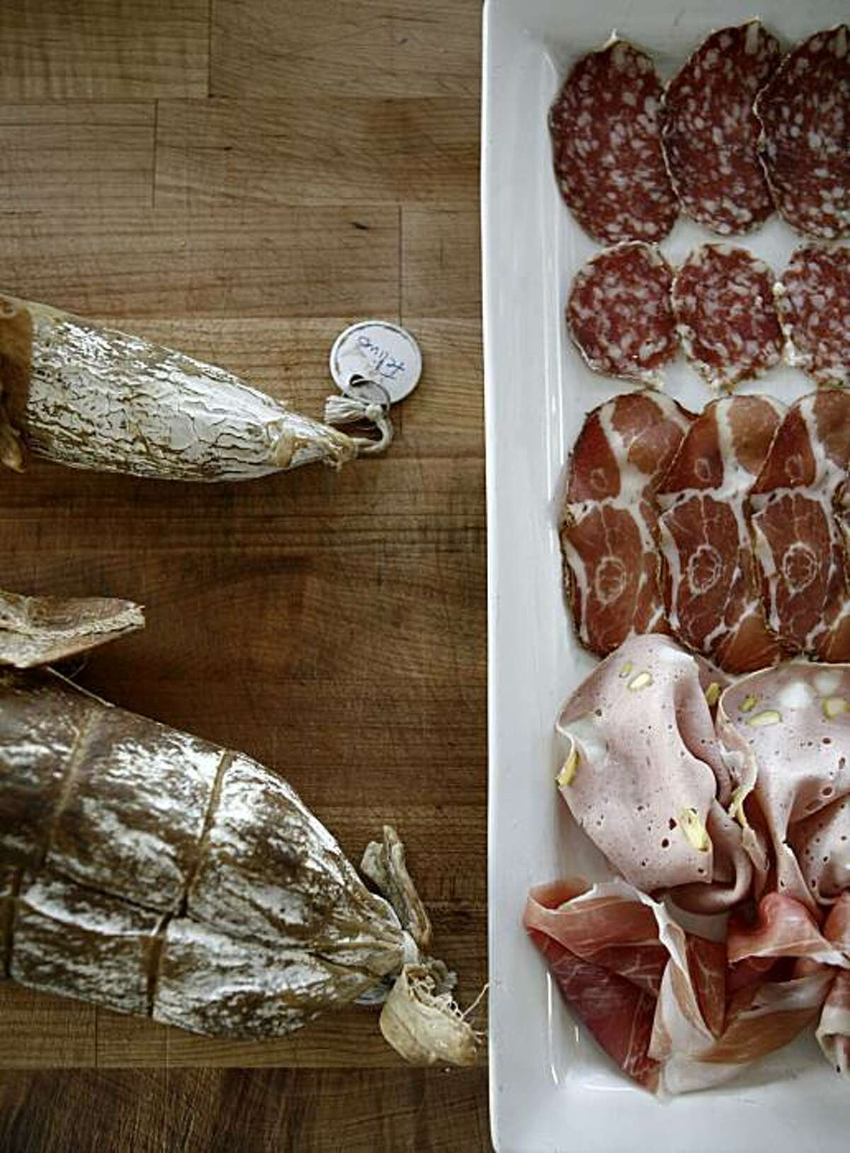 The salumi platter as it is being prepared at Adesso in Oakland.